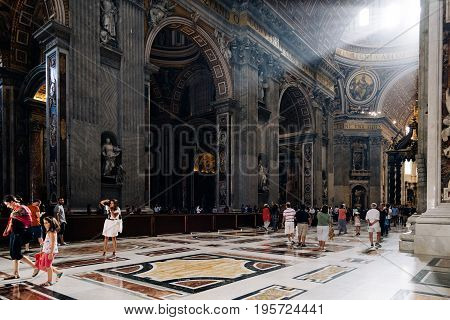 Rome Italy - August 19 2016: Interior view of St Peters Basilica. The Papal Basilica of St. Peter in the Vatican is an Italian Renaissance church in Vatican City the papal enclave within the city of Rome.