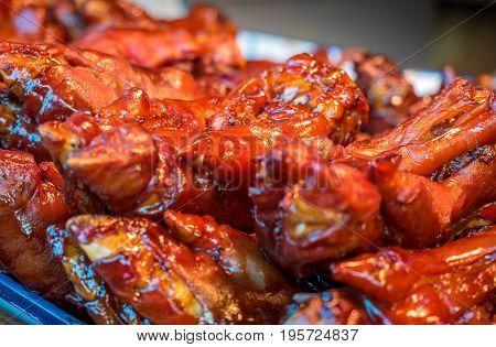 Roasted pork trotters, a favourite of the Suzhou region, China. Low-light, shallow depth of field image.