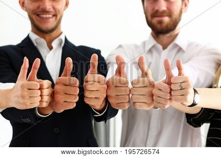 Group of people show OK or confirm with thumb up during conference closeup. High level quality product serious offer excellent education mediation solution creative advisor participation concept