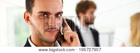 Handsome smiling businessman talk cellphone in office portrait. Stay in touch solution negotiate meeting job white collar busy life style electronic device store professional training concept