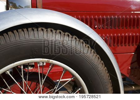 Radiated wheel of vintage red sports car