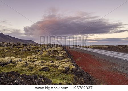Desolate road going through volcanic landscape in Iceland
