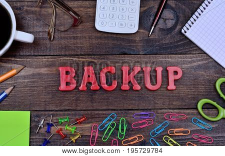 The word Backup on wooden table close-up