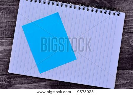 Notepad with empty notes on wooden table