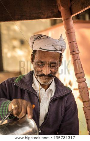 Muslim Indian preparing Masala Tea in Jaipur