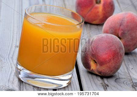 Peach juice in a glass on table
