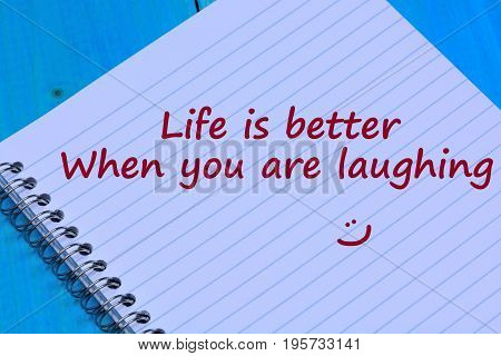Life is better when you are laughing words on notebook page