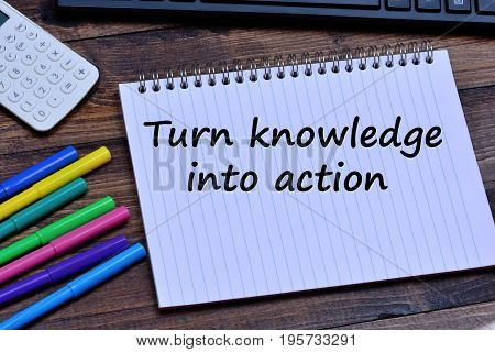 Turn knowledge into action words on notebook page