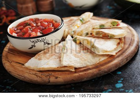 Mexican quesadillas, cheese filled tortilla slices with home made salsa