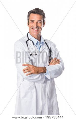 Portrait of smiling mature doctor isolated on white background. Happy senior doctor looking at camera and wearing white lab coat. Friendly male doctor posing with crossed arms.