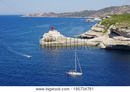The Gulf Of Bonifacio Offers A Natural Harbour For The Boats. The Lighthouse.
