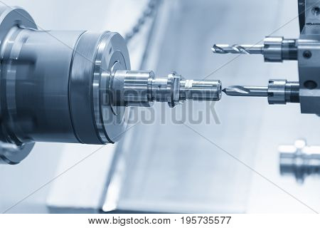 CNC lathe machine or Turning machine drilling the steel rod .Hi technology manufacturing process.