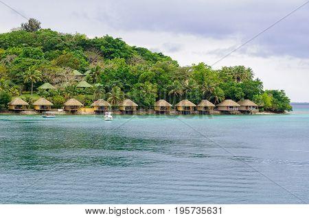 Luxurious over-water farés (bungalows) on the lush tropical Iririki Island - Port Vila, Efate Island, Vanuatu, 23 September 2012
