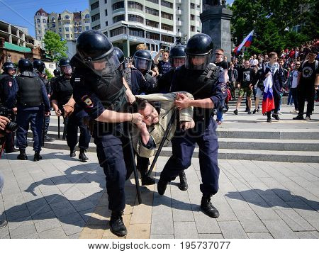 Vladivostok Russia - June 12 2017: An unidentified protester is arrested by riot police during a large rally against corruption.