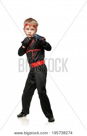 Young martial arts fighter practicing combat sport. Cosplay hero ninja