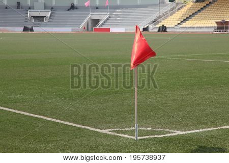 soccer corner flag in a large stadium filled