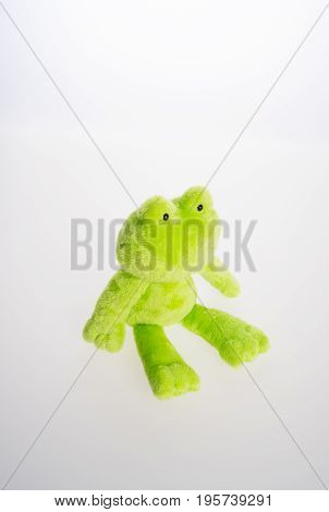 Toy Or Frog Soft Toy On The Background.