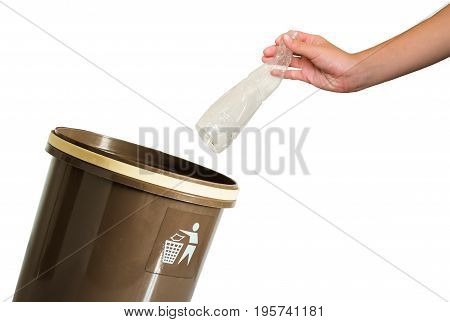 hand putting a bottle in recycling bin on isolated white background