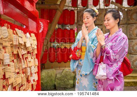 Girlfriends Pray, Red Lantern Background.