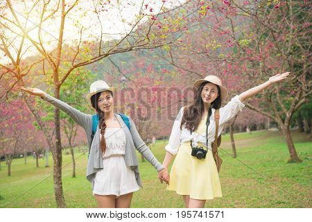 Women Friends Happy In Japan In Sakura Sanctuary.