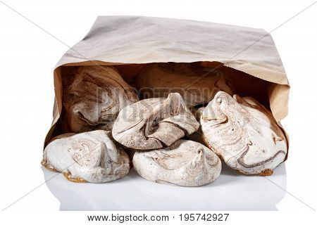 Homemade marble chocolate meringue cookies in paper bag Isolated on white
