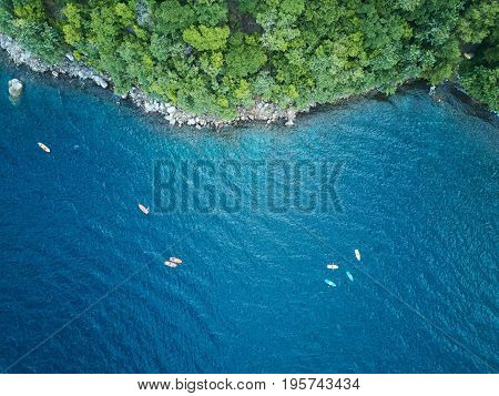 Kayaking adventure above view. Group of kayak in blue water