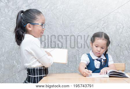 Little Teacher Looking Student To Doing Homework