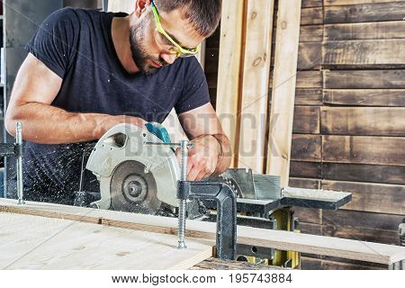 Man Sawing Wooden With A Modern Circular Saw
