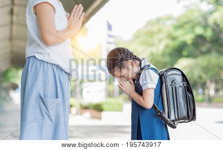Cute Girl Student Pay Respect To Her Mother