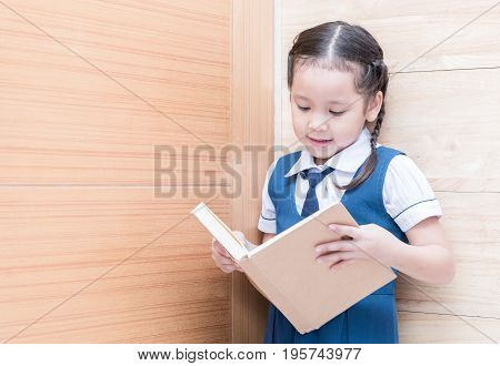 Asian Student Cute Girl Reading Book In  Library