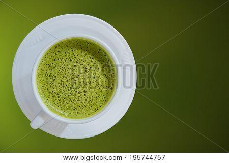 hot greentea healthy drink water on green background