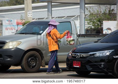 Man Sale Flower On Road Intersection