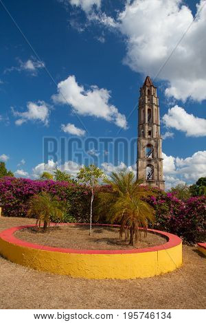 Manaca Iznaga old slavery tower near Trinidad Cuba. The Manaca Iznaga Tower is the tallest lookout tower ever built in the Caribbean sugar region.