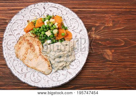 Turkey fillet with mushrooms in cream sauce and vegetables. Low fat healthy eating concept.