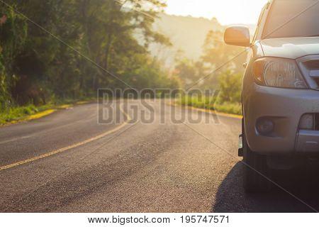 front side of car on old asphalt road and sunset travel concept