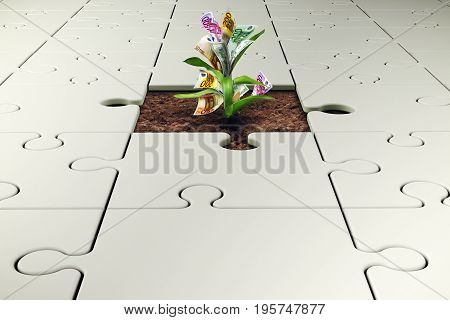 Plant grows from a white puzzle. Growth and development through teamwork concept