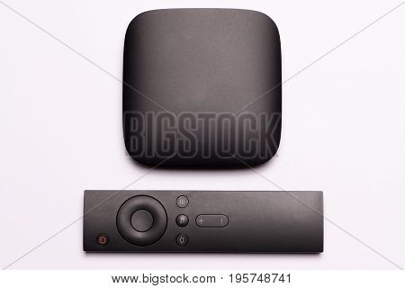 black multimedia TV box and remote controller