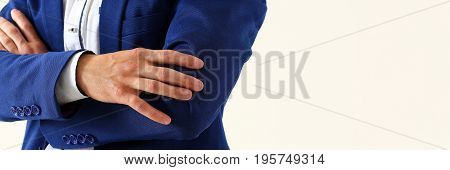 Male Hands In Suit Crossed On Chest Closeup