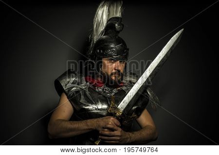 Empire, Roman centurion with armor and helmet with white chalk, steel sword and long red cape