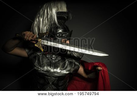 Army, Roman centurion with armor and helmet with white chalk, steel sword and long red cape