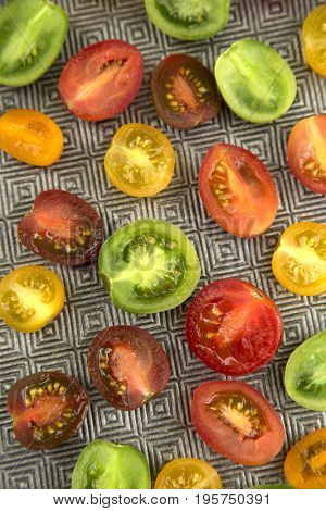 Top view of a various colored organics tomatoes