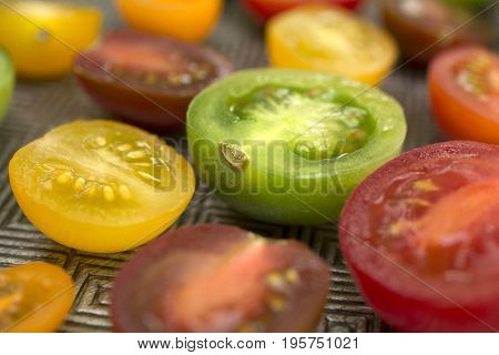 Various colored organics tomatoes cuts