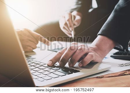 Close-up of business people using laptop computer and discussion document report. Financial Report Revenue Statistical Accounting Concept.