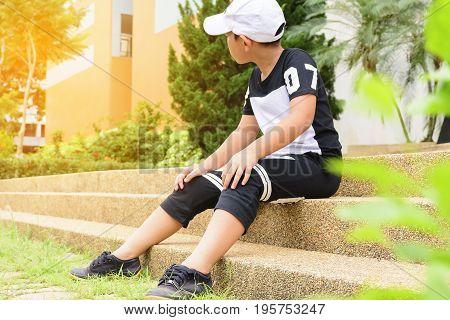 Asian student waiting his friend at international school.