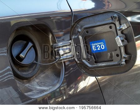 dark gray car fuel tank cap cover with blue label inside for Identify type of fuel, gasohol E 20