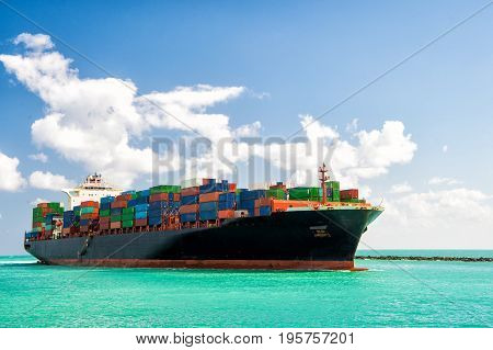 Cargo ship sailing to Miami delivery and logistic