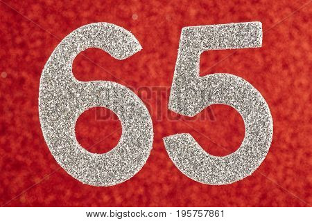 Number sixty-five silver color over a red background. Anniversary. Horizontal