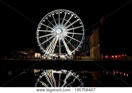 Ferris wheel in the old town of Gdansk at night
