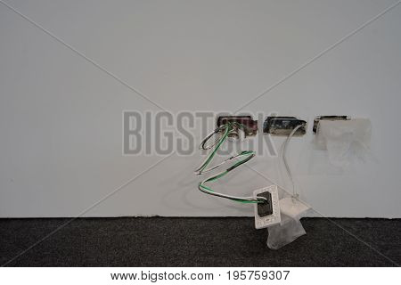 Exposed Wire In The Electrical Wiring In The Wall