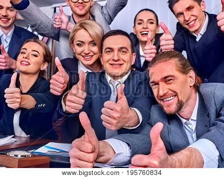 Business people office life of team people celebrate successful signing of contract. Team is happy from having won business deal and thumb up gesture. Team of employees is playing forex.